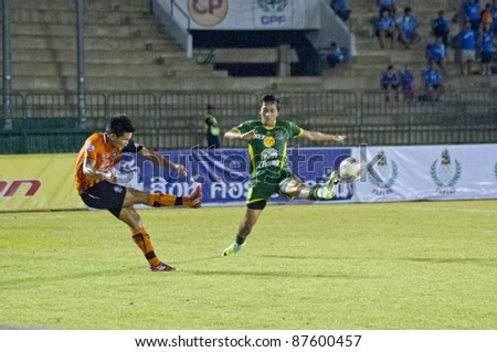 BANGKOK, THAILAND- OCT 26 : C.Jantakham (O) in action during Thaicom FA Cup between Army Utd. (G) vs Chonburi fc (O) on October 26, 2011 at Army Stadium in Bangkok, Thailand