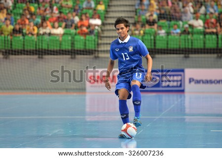 BANGKOK THAILAND-OCT9:Chaivat Jamgrajang of Thailand in action during 2015 AFF Futsal Championship Match between Thailand and Singapore at Bangkok Arena Stadium on October9,2015in Thailand