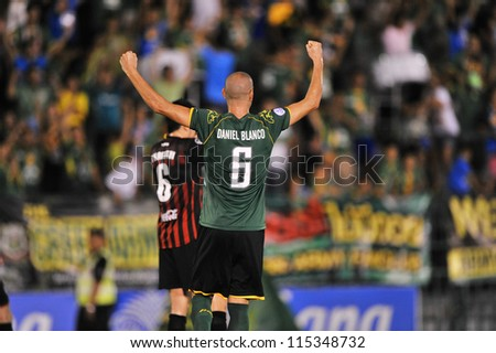 BANGKOK THAILAND-OCT3:Daniel Blanco (green) of Army United F.C.celebrate victory during Thaicom FA Cup between Army United F.C.and SCG Muangthong utd.at Thai Army Stadium on October3,2012 in Thailand