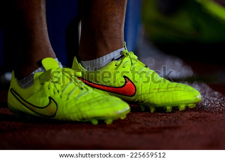 BANGKOK THAILAND-Oct15:Detail of soccer cleats during a match Thai Premier League Between Army Utd F.C.and Chonburi F.C.at Royal Thai Army Stadium on October15,2014 in Thailand - stock photo