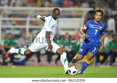 BANGKOK THAILAND - OCT 11: H.Osama of Sa in action during FIFA WORLD CUP 2014 between Thailand(B) and Saudi Arabia(W) at Rajamangla Stadium on Oct 11, 2011 Bangkok, Thailand. - stock photo