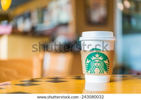 Bangkok ,Thailand- OCT 30, 2014 : Hot coffee cup Blended Beverages served at wood table in starbuck shop at Central Department store Rattatibet , Bangkok, Thailand. - stock photo