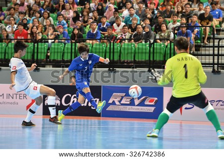 BANGKOK THAILAND-OCT11:Kritsada Wongkaeo(Blue) of Thailand in action during 2015 AFF Futsal Championship Match between Thailand and Brunei at Bangkok Arena Stadium on October11,2015 in Thailand
