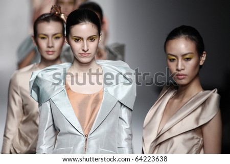 BANGKOK, THAILAND - OCT 22 : Model showcases on the catwalk during BIFW fashion show on October 22, 2010 in Bangkok Thailand. - stock photo