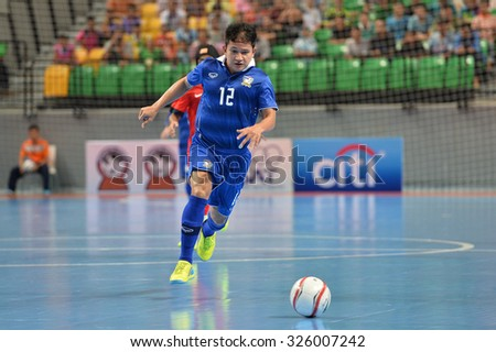 BANGKOK THAILAND-OCT9:Nuttavut Madyalan of Thailand in action during 2015 AFF Futsal Championship Match between Thailand and Singapore at Bangkok Arena Stadium on October9,2015in Thailand