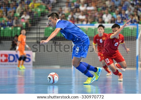 BANGKOK THAILAND-OCT14:Suphawut Thueanklang(Blue) of Thailand in action during 2015 AFF Futsal Championship Match between Thailand and Vietnam at Bangkok Arena Stadium on October14,2015 in Thailand