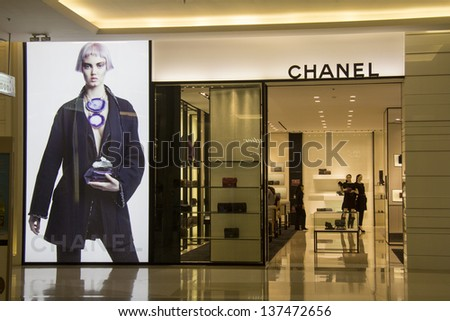 """BANGKOK, THAILAND - OCT 11th: Chanel store in Siam Paragon Mall on Oct 11th 2012. Chanel is one of many luxury brands to be found under the mall's """"Facet of Fashion"""" category. - stock photo"""