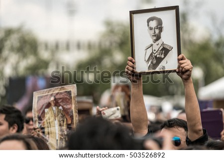 BANGKOK, Thailand - OCT 22: Unidentified people lift His Majesty King Bhumibol Adulyadej photo on October 22,2016 Bangkok, Thailand. Thailand's King has died after 70 years as head of state.