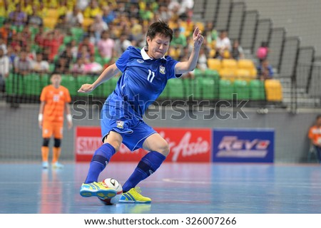 BANGKOK THAILAND-OCT9:Wanlop of Thailand in action during 2015 AFF Futsal Championship Match between Thailand and Singapore at Bangkok Arena Stadium on October9,2015in Thailand
