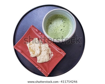 Bangkok, Thailand - Oct 4, 2014 : Warabimochi dessert and green tea on white background - stock photo
