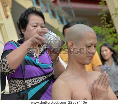Bangkok, Thailand - October 25, 2014 :A Thai male during Buddhism ordain ritual with his family at Wat Thapra Temple in Thonburi Area  Bangkok, Thailand - stock photo
