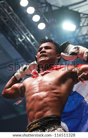 BANGKOK, THAILAND- OCTOBER 23 : Buakaw Por.Pramuk (THAI) winner, Buakaw Por.Pramuk (THAI) vs Mauro Serra (ITALY) 70 KG.  in THAI FIGHT 2012. on October 23, 2012 at Chanchai Acadium, Bangkok, Thailand