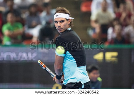 BANGKOK THAILAND OCTOBER 02:Rafael Nadal of Spain  watch the ball during the Black to Thailand Nadal vs Djokovic exhibition match at Hua Mark Indoor Stadium on Oct 2, 2015 in,Thailand. - stock photo
