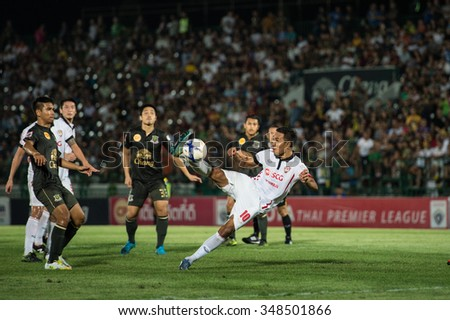 BANGKOK,THAILAND- OCTOBER31:Teerasil Dangda no.10 (white)of Muangthong United. in action during Thai Premier League 2015 Army Utd. and Muangthong United at Army stadium on Oct 31,2015 Bangkok,Thailand - stock photo