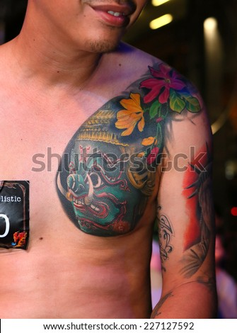 """BANGKOK, THAILAND - OCTOBER 23: Unidentified contestant's tattoo at MBK Center """"MBK TATTOO CONTEST 2014 Vol.9 THAI INK RETURN"""" on October 23, 2014 in Bangkok, Thailand - stock photo"""