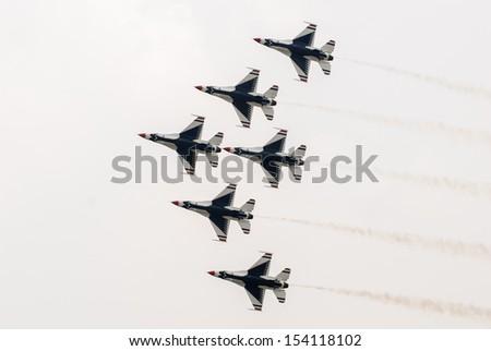Bangkok, Thailand - October 9, 2009: United States Air Force Thunderbirds official military aerobatic team during an exhibition, at Royal Thai Air Force Base, Bangkok, Thailand    - stock photo