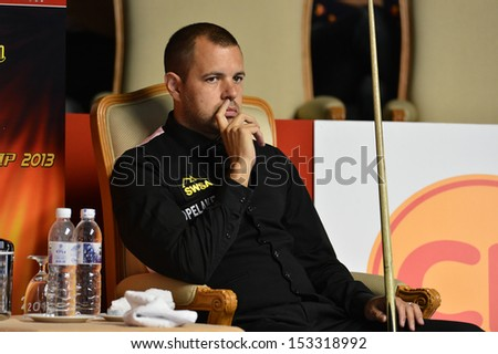 BANGKOK,THAILAND-SEP 3,2013: Barry Hawkins player of England in action during Snooker 6-Red World Championship 2013 at Montien Riverside hotel on September 3,2013 in Bangkok, Thailand
