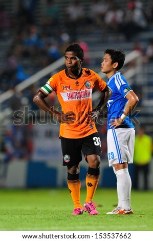 BANGKOK,THAILAND-SEP 08 : GUY Hubert (O) of Samutsongkhram FC in action during Thai Premier League 2013 between TOT SC and Samutsongkhram FC at TOT stadium on September 8,2013 in Bangkok,Thailand