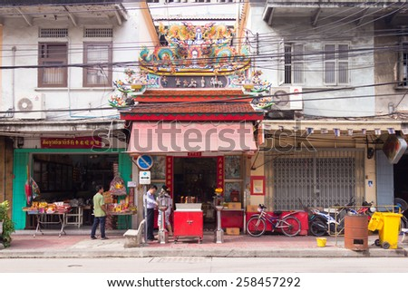 bangkok, Thailand-Sep 25th 2012: Chinese temple in street in Chinatown. The area is one of the oldest parts of Bangkok. - stock photo