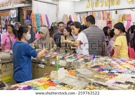 Bangkok, Thailand-Sep 20th 2014: Shopping in Sampeng Lane. The street is a famous shopping area in Chinatown. - stock photo
