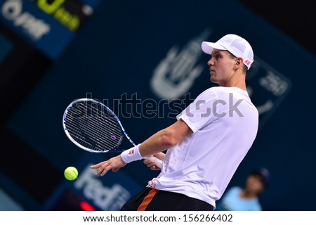 BANGKOK,THAILAND-SEP 28:Tomas Berdych of Czech Republic returns the ball during match against Gilles Simon of France  at Thailand Open 2013 on September28, 2013 at Impact Arena,Bangkok,Thailand