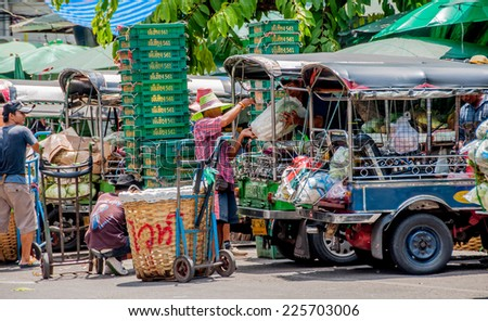 BANGKOK,THAILAND - SEP 20:Unidentified man transports vegetable by Tuk Tuk car at Pak Khlong Talat  market in Bangkok,Thailand on 20 September 2013. - stock photo
