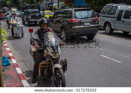 Bangkok, Thailand - Sep 12, 2015 Unidentified traffic policman with his motorcycle on street of Yaowarat or China town of Thailand