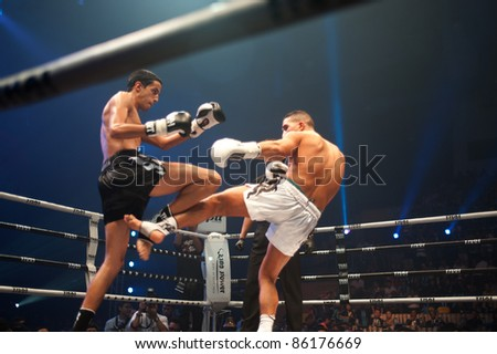 BANGKOK, THAILAND-SEPT 25: Unidentified fighters fight Muaythai at 'Thai Fight Muay Thai ...The World's Unrivaled Fight' at Thammasat University stadium on September 25, 2011 in Bangkok,Thailand
