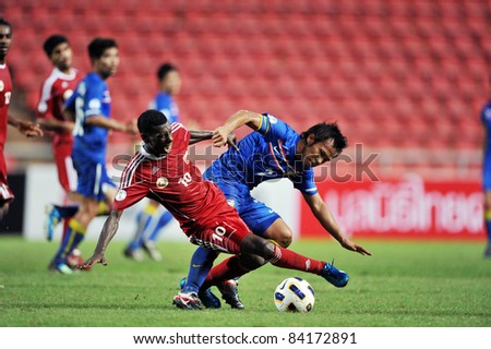 BANGKOK THAILAND - SEPTEMBER 6 : D.Thonglao of Thailand in action during FIFA WORLD CUP 2014 (Round 3), between Thailand(B) and Oman(R) at Rajamangla Stadium on September 6, 2011  Bangkok, Thailand.