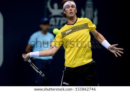 BANGKOK,THAILAND-SEPTEMBER 23:Daniel GIMENO-TRAVER(ESP)in action during match against Robin Haase(NED) at Thailand Open on September23, 2013 at Impact Arena Muang Thong Thani, Bangkok, Thailand  - stock photo