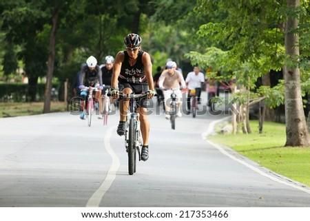 BANGKOK THAILAND -September 15- group of bikers are riding bikes in bicycle lanes of at the Vachirabenjatas Park (Rot Fai park) of Bangkok on September 15 ,2014 in Bangkok, Thailand  - stock photo