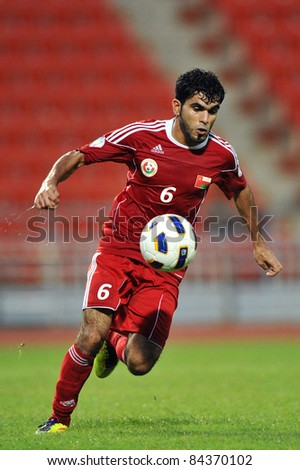 BANGKOK THAILAND - SEPTEMBER 6 : J.Mubarak of Oman in action during FIFA WORLD CUP 2014 (Round 3), between Thailand(B) and Oman(R) at Rajamangla Stadium on September 6, 2011  Bangkok, Thailand. - stock photo