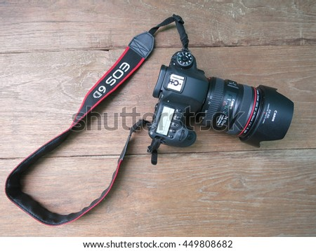 BANGKOK, THAILAND - September 21,2015: Photo of Canon Eos 6D camera with EF 24-70mm F/4 IS USM Lens Kit on black background
