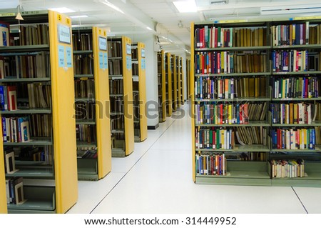 BANGKOK, THAILAND - 10 SEPTEMBER : Row of bookshelves in a public library of Thammasat University on September 10, 2014.  - stock photo