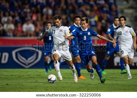 BANGKOK,THAILAND SEPTEMBER 08:Saad Abdul-Amir no.21 (white) of Iraq  in action during the 2018 FIFA World Cup Qualifier between Thailand and Iraq at Rajamangala Stadium on Sep 8, 2015 in Thailand. - stock photo