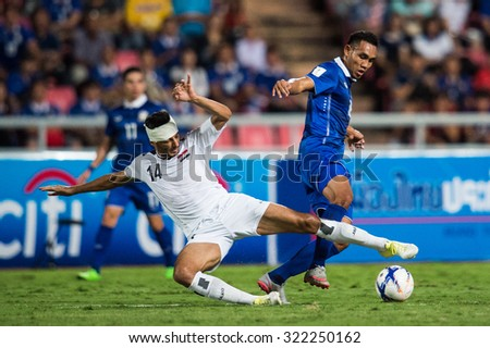 BANGKOK,THAILAND SEPTEMBER 08:Salam Shaker no.14 (white) of Iraq  in action during the 2018 FIFA World Cup Qualifier between Thailand and Iraq at Rajamangala Stadium on Sep 8, 2015 in Thailand. - stock photo