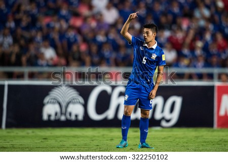 BANGKOK,THAILAND SEPTEMBER 08:Sarach Yooyen no.6 of Thailand in action during during the 2018 FIFA World Cup Qualifier between Thailand and Iraq at Rajamangala Stadium on Sep 8,2015 in Thailand. - stock photo