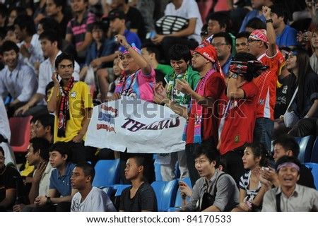 BANGKOK THAILAND - SEPTEMBER 6 : T.Dangda of Thailand in action during FIFA WORLD CUP 2014 (Round 3), between Thailand(B) and Oman(R) at Rajamangla Stadium on September 6, 2011  Bangkok, Thailand.