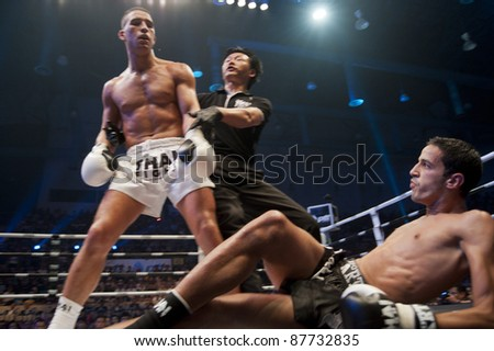 BANGKOK, THAILAND- SEPTEMBER 25 : Unidentified boxers compete in Thai Fight:Muay Thai. World's Unrivalled Fight on September 25, 2011 at Thammasat University Convention Center, Bangkok, Thailand