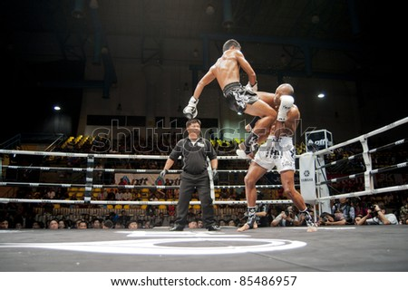 BANGKOK, THAILAND- SEPTEMBER 25 : Unidentified players  compete in Thai Fight:Muay Thai. World's Unrivalled Fight on September 25, 2011 at Thammasat University Convention Center, Bangkok, Thailand