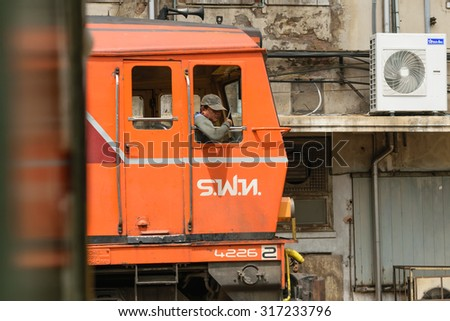 Bangkok, Thailand - September 12, 2015 : Unidentified railway employees driveing the locomotive for switching the railway before serving at State Railway of Thailand.