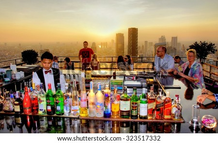 BANGKOK - THAILAND ;  Sunset view from the Vertigo and Moon Bar - Banyan Tree Hotel on 3 december 2011.This bar is 61 floors above the bustling streets of Bangkok, overlooking a magnificent cityscape. - stock photo