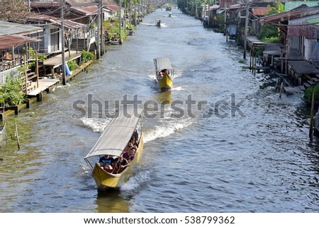 BANGKOK - THAILAND / 02.12.2015: Tourists boats at the Damnoen Saduak Floating Market in Bangkok
