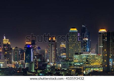 Bangkok various high-rise buildings including famous luxury hotels, condominiums, commercial buildings at night - stock photo
