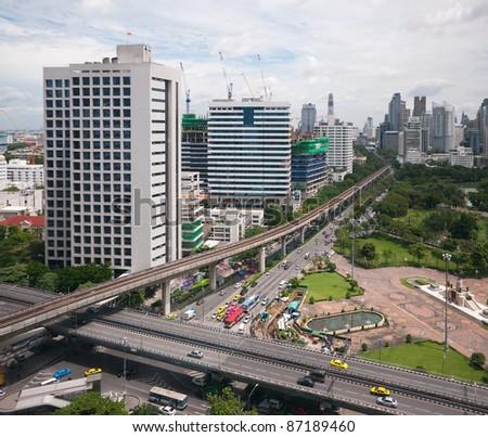 Bangkok view with Rama IV road in the foreground and Rachadamri road with Silom Sky-train line disappearing into the background. Two buildings on the left are the Red Cross Chulalongkorn Hospital.