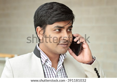 Bangladesh business man talking to the phone - stock photo