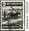BANGLADESH - CIRCA 1973: A stmp printed in Bangladesh shows farmer plowing a rice field on the Bulls, circa 1973 - stock photo