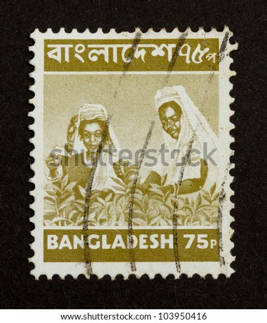 BANGLADESH - CIRCA 1970: Stamp printed in Bangladesh shows two working locals, circa 1970 - stock photo