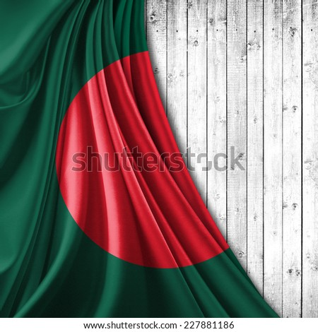 Bangladesh flag and wood background - stock photo