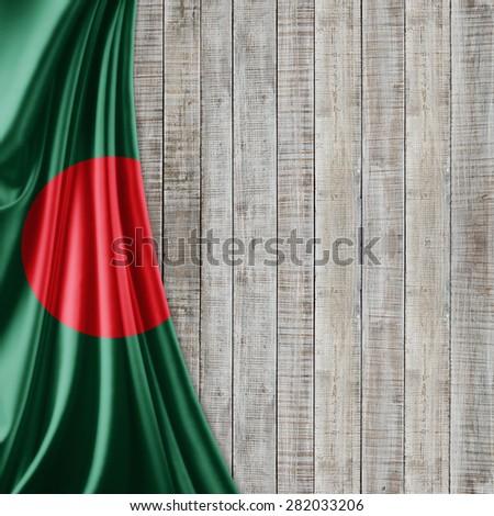 Bangladesh  flag of silk and wood background - stock photo